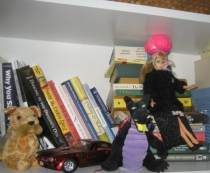 Jean Cook's Creative Brain hangs out with books, Barbie and a dragon. Where's yours?
