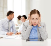 26692259 - business, technology, internet and office concept - stressed businesswoman with tablet pc computer