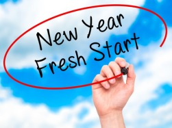 52800366 - man hand writing new year fresh start with black marker on visual screen. isolated on sky. business, technology, internet concept. stock photo