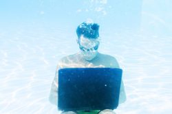 immersed in creative flow underwater with laptop