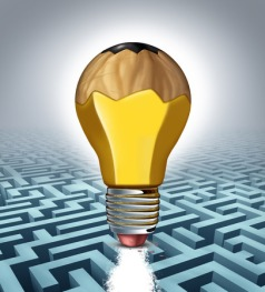 27496622 - creative solution business concept as a pencil shaped as a three dimensional lightbulb erasing a clear path through a maze puzzle as a success metaphor for creativity thinking and innovative strategy