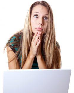 woman with laptop praying